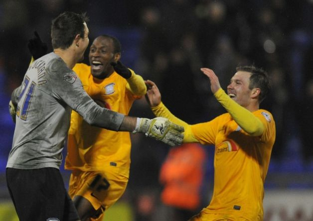 Preston North End's Thorsten Stuckmann is mobbed by team mates after scoring the winning penalty