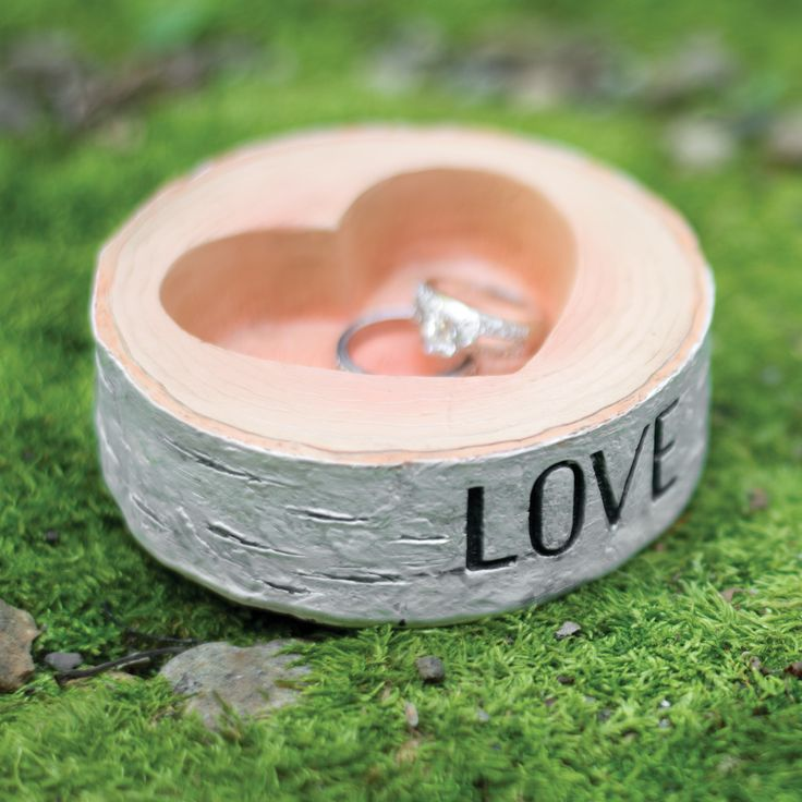 """Use this rustic inspired resin, faux-birch wedding ring bowl holder to store your wedding ring collection before, during and after your wedding ceremony. The word """"Love"""" is inscribed in black on the f"""