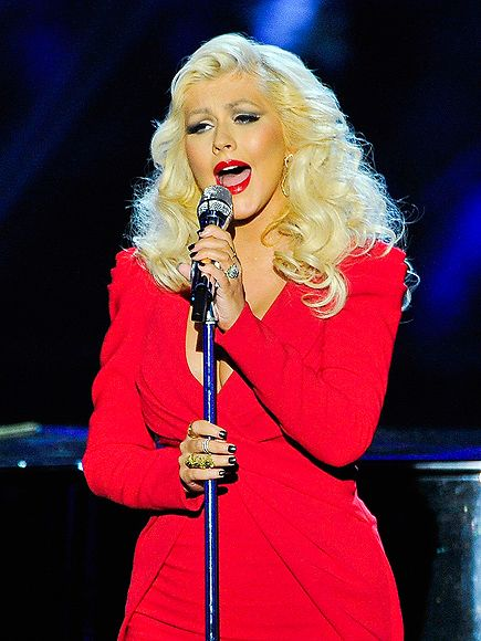 Star Tracks: Monday, November 10, 2014 | RED HOT MAMA | Just three months after giving birth to her daughter Summer Rain, singer Christina Aguilera belts it out onstage during the Breakthrough Prize Awards Ceremony on Sunday in Mountain View, California.