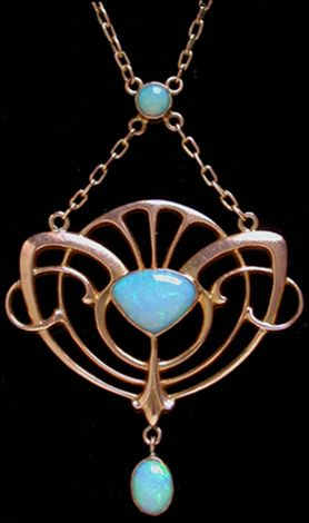 BARNET HENRY JOSEPH An Art Nouveau gold pendant set with a central opal suspended from another opal pearl panel and an opal drop. English. Circa 1900