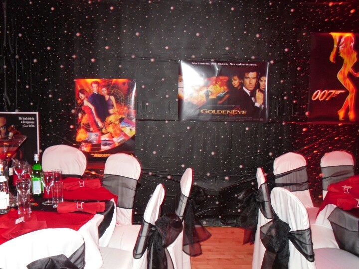www.la-occasion.com - James Bond Themed Party Black Starcloth with James Bond Posters stuck on