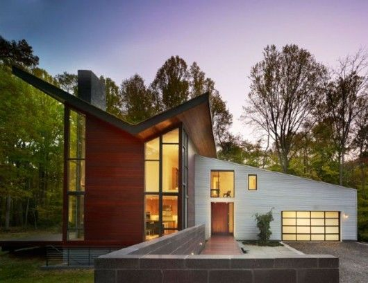 Great Architect Robert M. Gurney Designed This House With A Dramatic Wall Of  Polished Concrete Blocks At The Entrance. The Butterfly Roof Volume  Features Exterior ...