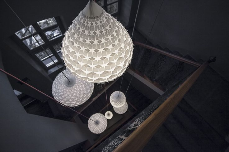 The white designed lamp in the staircase