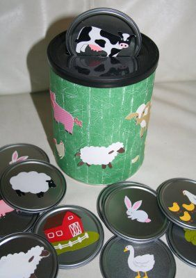 Cut slit in the top of empty coffee bin. Take the lids off frozen juice and add farm stickers. Decorate coffee bin. Repinned by playwithjoy.com. For more task box pins visit pinterest.com/playwithjoy