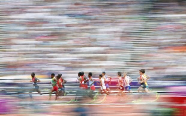 Athletes compete in their men's 5000m round 1 heat at the London 2012 Olympic Games at the Olympic Stadium REUTERS/DAVID GRAY