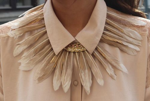 Feather necklace.Details in streetstyle