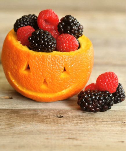 """Carve out a clementine and let this creative """"pumpkin"""" bowl take center stage at the breakfast table on Halloween morning. It's fun and healthy to keep both kids and parents happy."""
