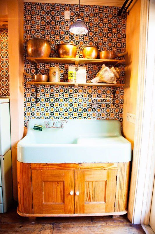 love the old cast iron enamel sink and moroccan tile wall