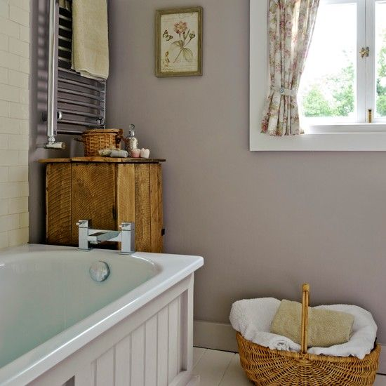Country bathroom with neutral walls, tiles and panelling