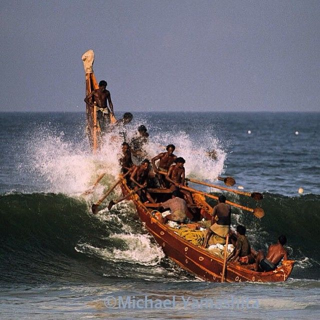 Photo by Michael Yamashita. @yamashitaphoto.  Fishermen in Kovalum, India, use no motors, just 50 lb. oar power to jump the waves. #Kerela #india @thephotosociety @natgeocreative