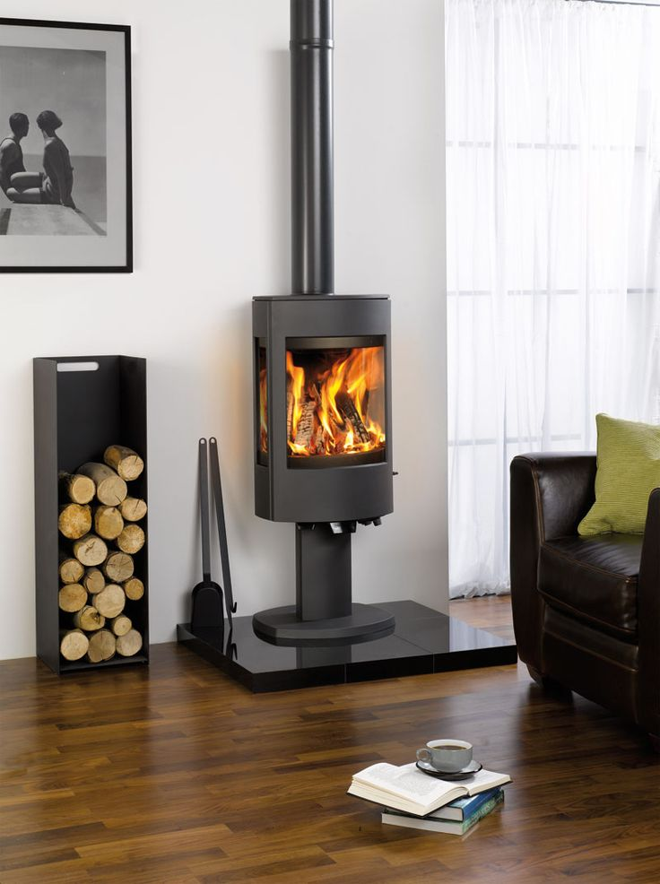 The Astroline 4CB stove is available in either wood burning or multi-fuel versions and with a choice of pedestal or wood store bases.