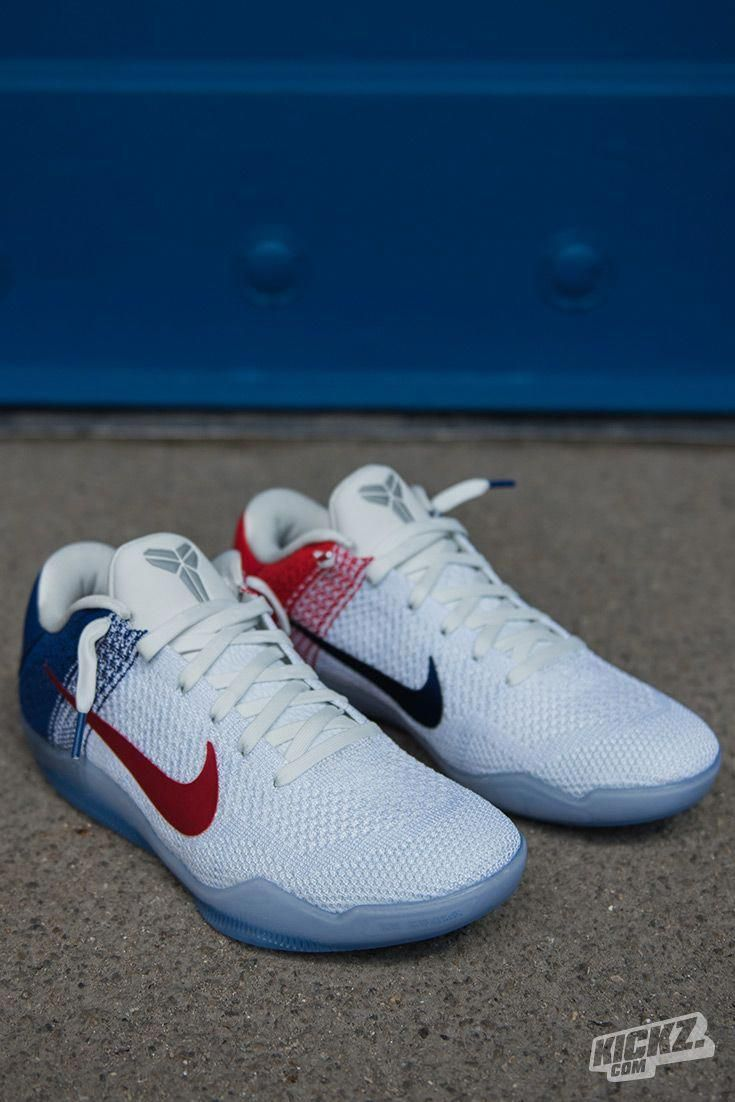 promo code dfd78 eb074 Ready for July 4th and the Olympics  The Nike Kobe XI Elite Low USA  basketball shoe features a white, blue and red color scheme. The heel shows  Kobe s 2 ...