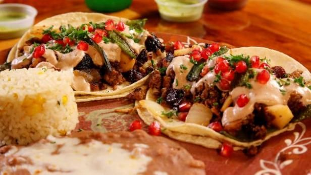 Guy tastes the sweet-and-spicy gourmet tacos at La Santisima in Phoenix.