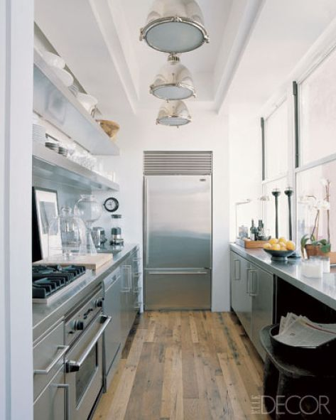 Combination of sleek stainless steel and rustic salvaged for Expanding a galley kitchen