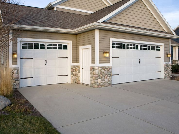 Garage door accents.  Faux windows and quality hardware.