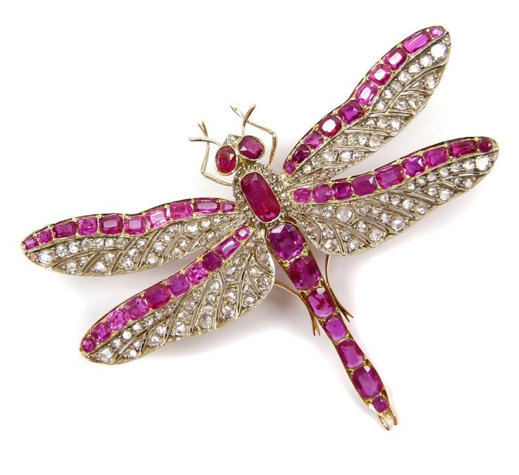 19th century ruby and diamond tremblant dragonfly brooch, French c.1890, the pierced rose diamond set wings each with a line of rubies along the top edge, an oblong ruby and diamond cluster forming the thorax, line of seven cushion cut rubies down the abdomen, and two ruby eyes, open set in gold,