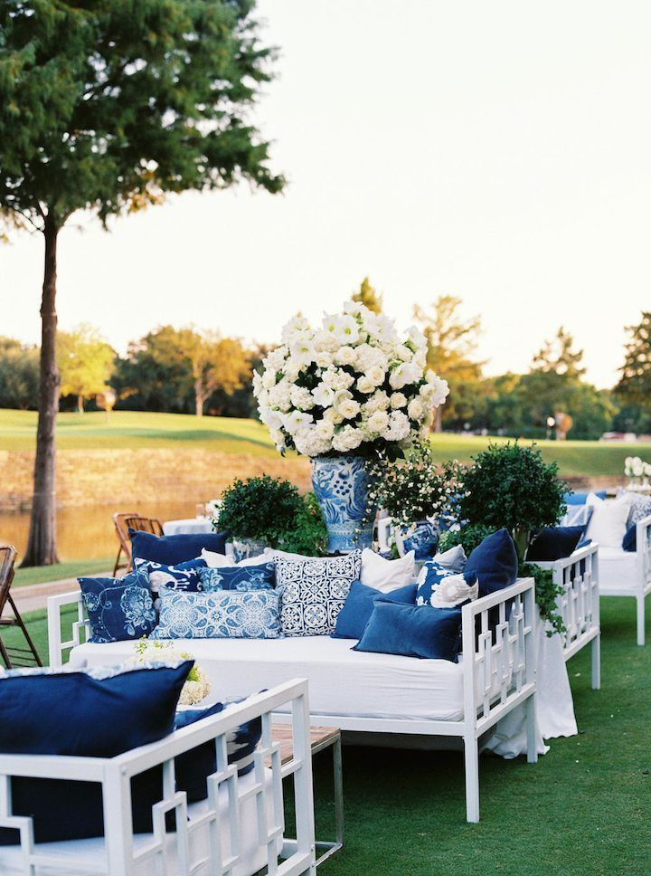fabulous lounge areas are a great way to add interest to your outdoor party. love the blue and white theme of these little conversation spots.