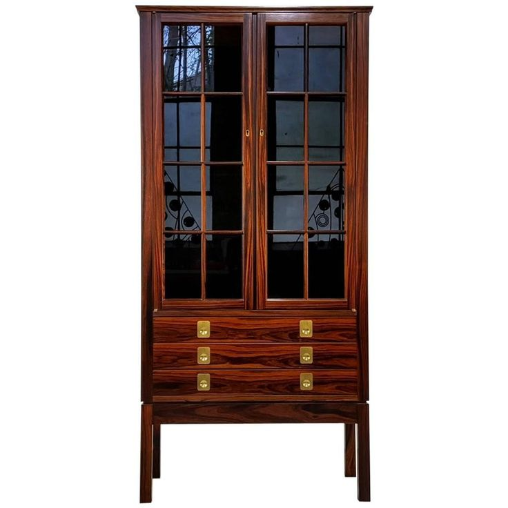 Rosewood Lighted Curio Cabinet by Torbj�rn Afdal, Norway, 1960s | From a unique collection of antique and modern cupboards at https://www.1stdibs.com/furniture/storage-case-pieces/cupboards/