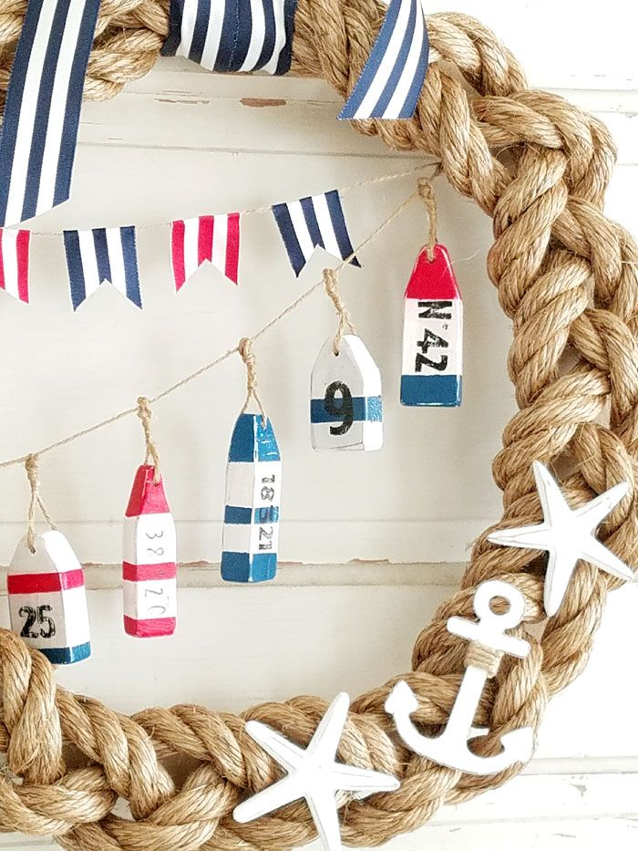 DIY Rope Nautical Wreath - an awesome DIY project for the summer! A super cute combo of rope and ribbon to make this nautical wreath!