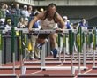 Decathlete Bryan Clay grabs last hurdle in decathlon 110m hurdles at the U.S. Olympic athletics trials in Eugene, Oregon June 23,