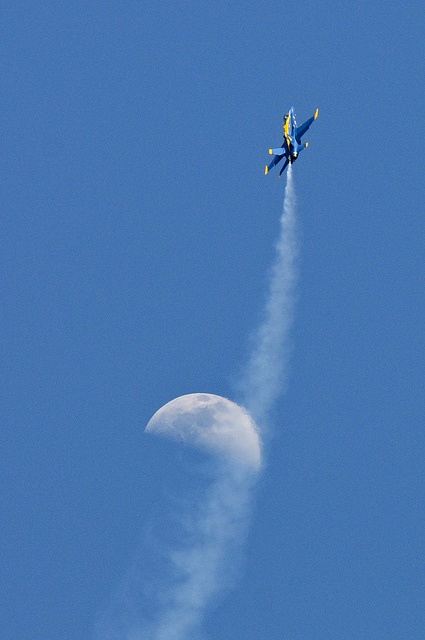 Jet from the Blue Angels performs during air show.