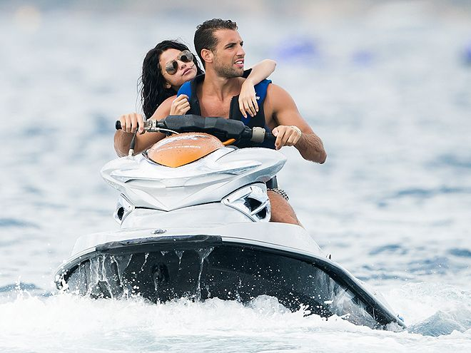 She's having a happy birthday! Selena Gomez holds on tight to a handsome mystery man during a WaveRunner ride Tuesday in St. Tropez, France.