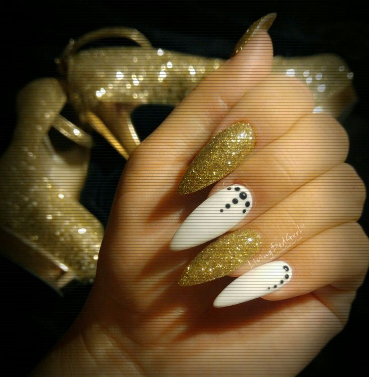 #Christmas #gold #glitter #stiletto #nails #nailart #naildesign (mine) by Christie at Klassy Nails and Spa in Gilbert, AZ