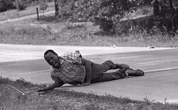June 6, 1966 - Civil rights activist James Meredith grimaces in pain as he pulls himself across Highway 51 in Hernando, Miss. after being shot during a voting rights march.  Meredith, who defied segregation to enroll at the University of Mississippi in 1962, completed the march from Memphis, Tenn., to Jackson, Miss., after treatment of his wounds. (AP Photo/Jack Thornell)