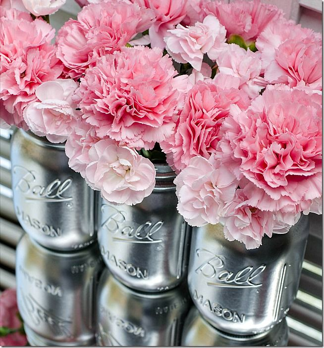 Spray paint mason jars with silver metallic paint and turn them into elegant vases. Find out how easy it is to make your own by clicking this link.