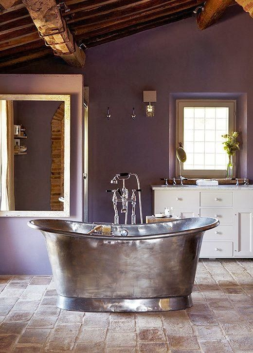 Wild Orchid.  Sherwin Williams has also announced their paint color of the year and it's in the same family but not so wild and vibrant.   It's a rich deep grey/purple  version called Smokey Plum: