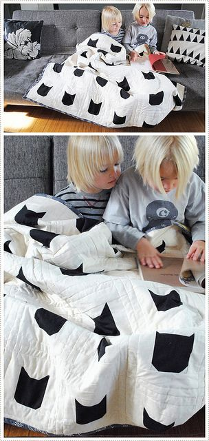 This may officially make me a crazy cat lady but I kinda love this simple graphic cat quilt