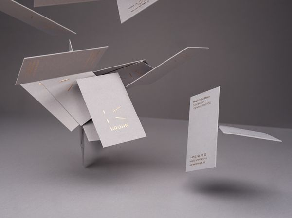 Business cards that utilises grey paper and boards with gold foil print finish for Oslo-based furniture, interior and architecture studio Krohn designed by Commando Group