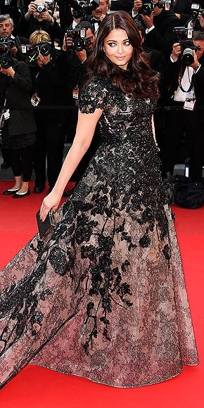 AISHWARYA RAI The former Miss World makes quite the entrance at the Inside Llewyn Davis celebration, hitting the red carpet in a major Elie Saab gown that combines both a lace print and a shimmery lace embroidery.