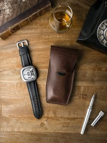 """Bas and Lokes chocolate """"Kingsford"""" handcrafted leather watch pouch. Next to it is a handsome SevenFriday watch paired with our """"Kingsman"""" black leather watch pouch. Pouch and strap are both a vailable at www.basandlokes.com"""