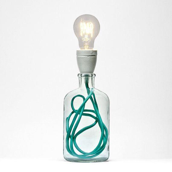Table lamp made from glass bottle, fabric cable that includes translucent switch and plug. Perfect ambient light for any corner of your house.