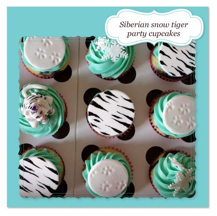 Snow Tiger theme cupcakes, complete with tiger footprints in the snow and a hint of edible glitter.
