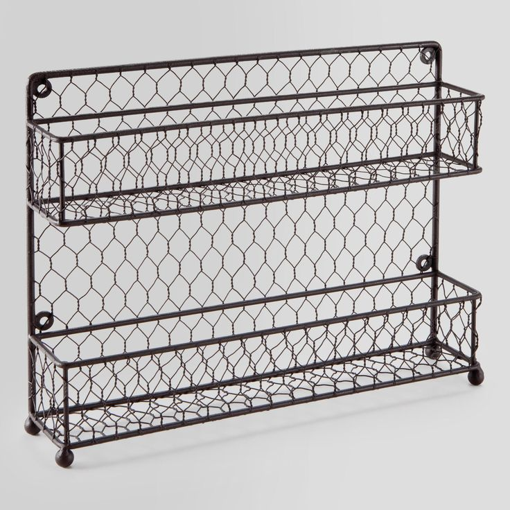 Whether you hang it or sit it on your countertop, you'll love the homespun look of our Wire Two-Tier Spice Rack. Crafted of chicken wire with a rustic finish, this handy spice holder will keep your salt, pepper, paprika, cinnamon and more front and center.