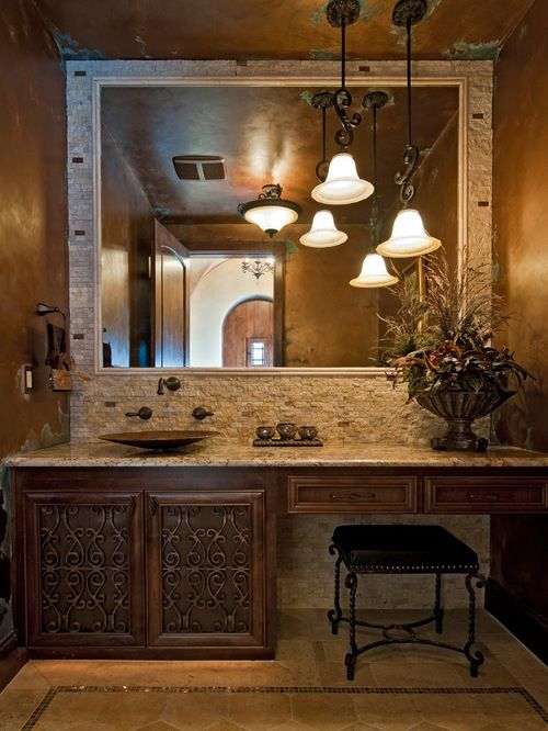 Beautiful bathroom in Mediterranean style with a large mirror, dark cabinets and travertine floor #travertine #floor #bathroom #interior #naturalstone #decor