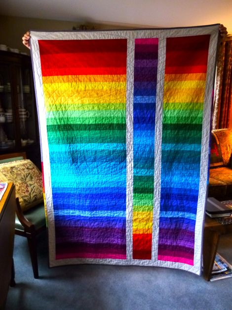 This was a jelly roll of Moda's Brights. I just put them together as they came off the roll. After squaring it up, I cut a piece out and turned it around for visual interest. It is outlined in Kona Ash and the binding is of Kona Charcoal with bits of offcuts in the binding.