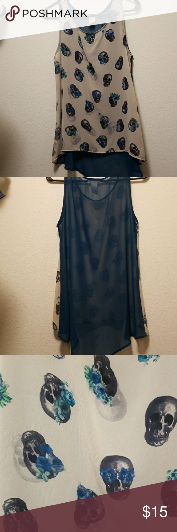 Skull Tank Top See through cream and teal skull tank top. Gently used. Misope Tops Tank Tops