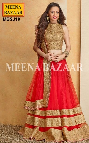 Red Net Lehenga Choli - Look Royal on your Special Day with this Lehenga that Flaunts Ethnic Craftsmanship . Exquisite Zari and Sworovski studded designs and patterns on the Patch Patti planted at reglar intervals at the hem makes the Lehenga look absolutely Fabulous. It is paired with Choli beautifully embellished with similar adornment as Lehenga. The Net Dupatta has Scattered Swarovski crystals and Golden beads on the border all over Aggrandizing the Appearance.