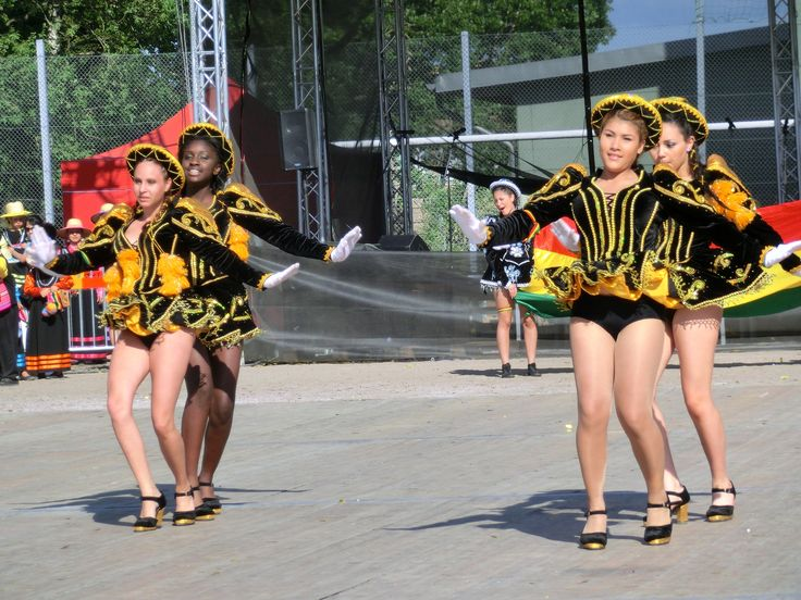OH MY! Cute Caporales girls dance at a festival! The girl on the right's little black panties are almost completely exposed during her performance!!
