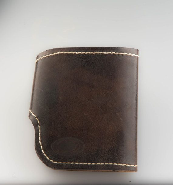 Mens wallet of the three types of skin. 4 slots for credit cards. Branch under the coins and large compartment under the bill. Purse sewn by hand waxed thread. Size: height 115 mm. width 95 mm. and 105 mm at the widest point.  Handmade from start to finish! Each piece is cut and sewn by hand using waxed thread. No machines, only handmade!  Мужской кошелек из трех видов кожи. Четыре отделения под карты. Отделение под монеты,и большое отделение под купюры. Кошелек прошит в ручную вощеной…