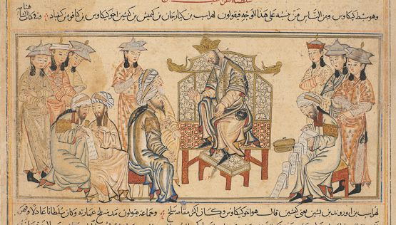 this image depicts Key Khosrow's successor, Lohrasp, enthroned. Here we see figures characteristic of the Il-Khanid court: young attendants wear split-brimmed Mongol caps with their hair in bunches, while old, bearded figures with aquiline profiles have turbans. The latter have long written scrolls and pen-boxes.  They are Persian bureaucrats, indispensable to the running of the empire. The lotus decoration on the throne back is typical for the period.
