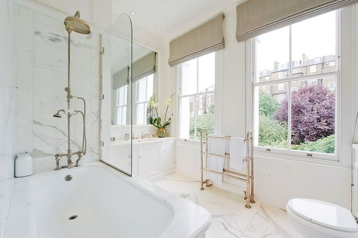 Suzie: Stunning master bathroom with mushroom linen roman shades, floor-mount towel warmer, ...