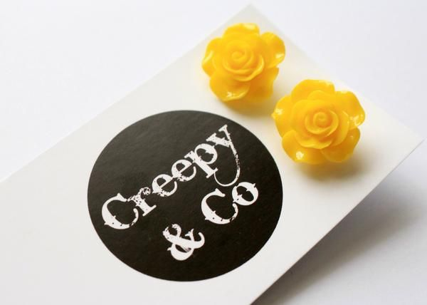 Bright Yellow Rose Stud Earrings.  Rose stud earrings are the perfect accessory to brighten your style.  The bright yellow colour pops, making you look like the cutest pinup doll going around. Repin.