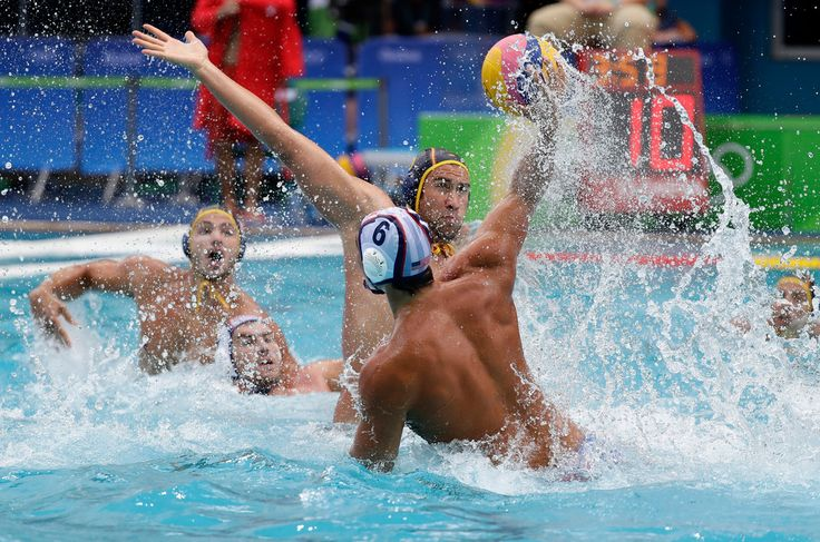 . United States' Luca Cupido shoots and scores against Spain during men's water polo preliminary round match at the 2016 Summer Olympics in Rio de Janeiro, Brazil, Monday, Aug. 8, 2016. (AP Photo/Sergei Grits)