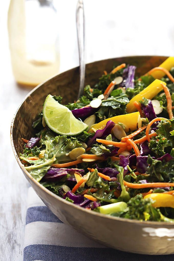 Asian Kale Salad with Creamy Peanut Dressing--Crunchy kale and peppers tossed with red cabbage, carrots, creamy homemade peanut dressing and topped with almonds.  Add tofu or edamame to boost the protein.