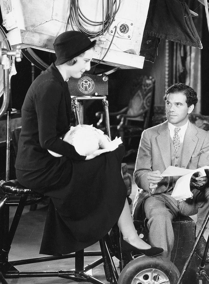 Barbara Stanwyck with director Frank Capra on the set of Forbidden, 1932