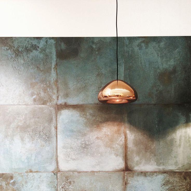 oxidized brass kitchen splashback